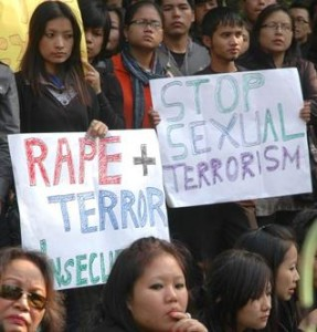 People protest against the rape of a North-East student